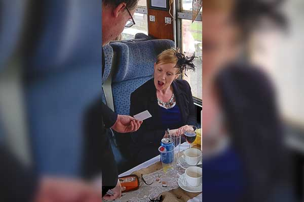 Rob Hutchinsion Magician Entertaining Train Passengers